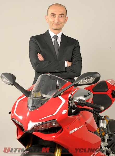 Claudio Domenicali next to the Ducati 1199 Panigale R