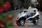2011-piaggio-mp3-hybrid-300-preview 5