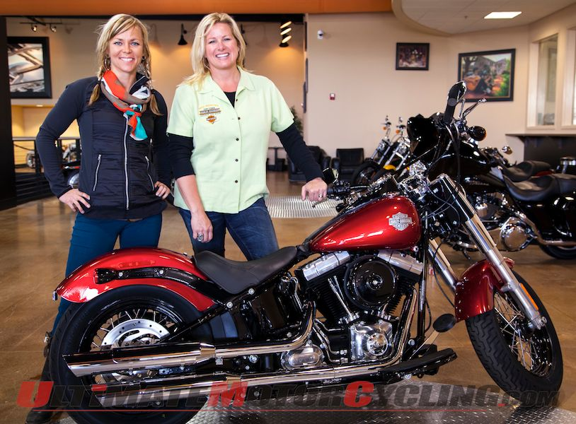 Jessi Combs next to the Harley-Davidson Softail Slim donated by Bruce Rossmeyer's Daytona Harley-Davidson