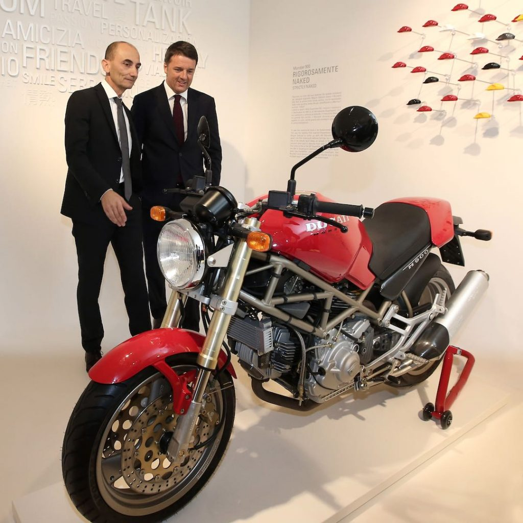 CEO Claudio Domenicali with Italian Premier Matteo Renzi and Monster 900 at new Ducati Museum