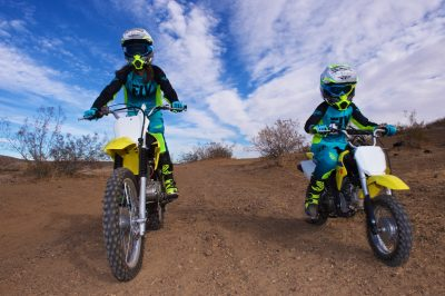 Mother, Daughter, and Dirt Bikes Head-on Suzukis