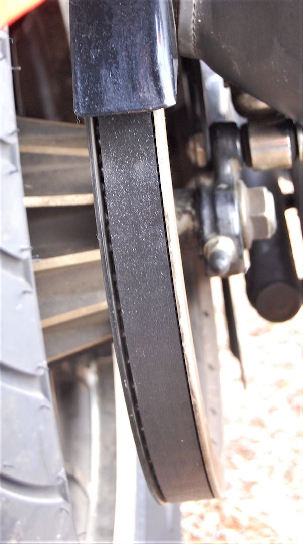The clearance between the new drive belt and sides of the pulley is visible in this view of the 2007 Sportster.