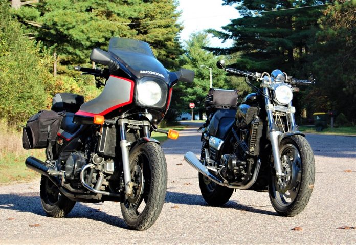 Side-by-side V4s—The Honda VF1100S (L) with the optional frame mount fairing and the Yamaha VMX1200 with aftermarket drag bars—the same only different?