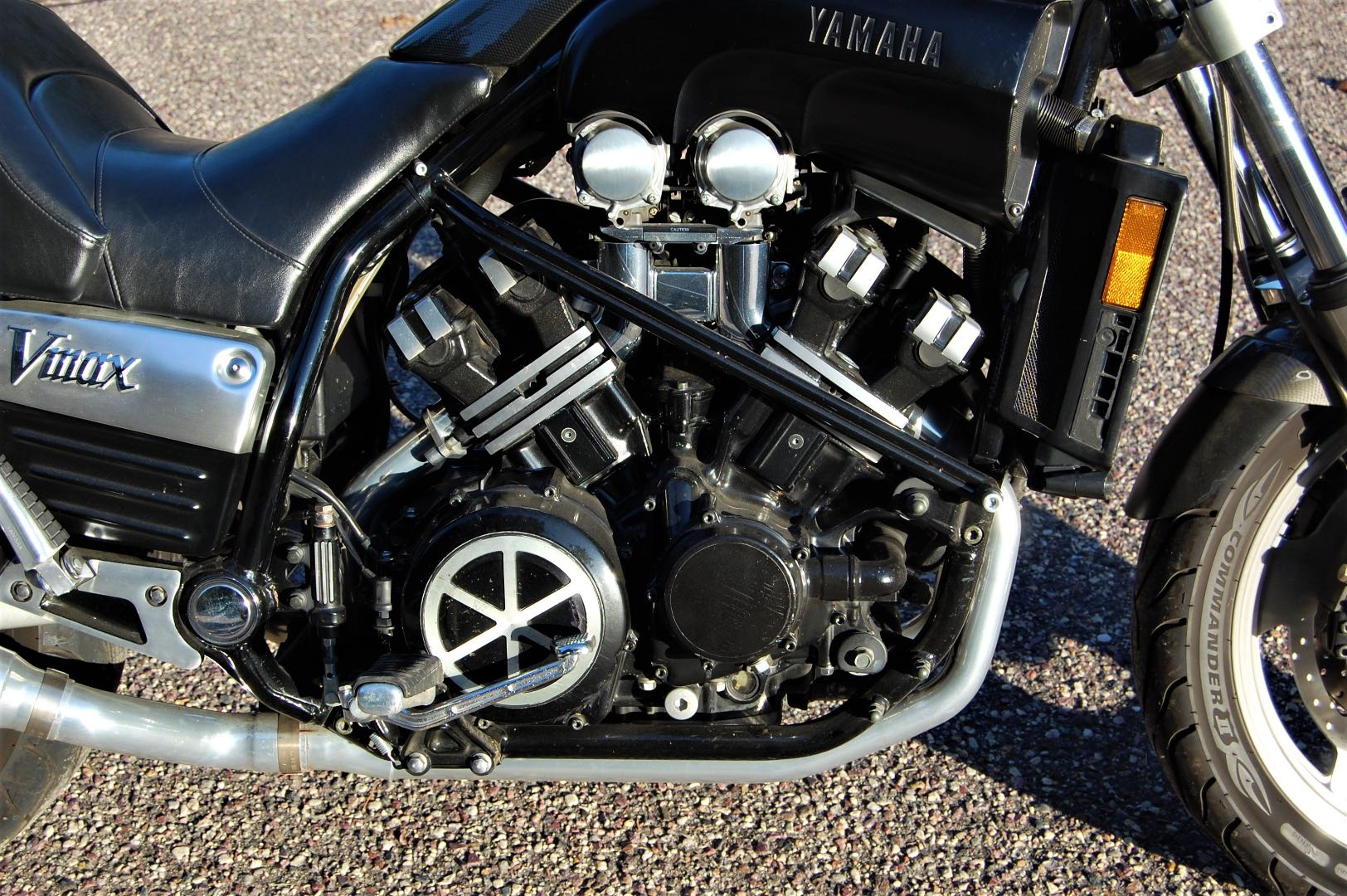 The Vmax engine is pure industrial art. With the engine's mass carried low in the frame and the four-gallon gas tank under the seat, the VMax achieves a lower center of gravity than the Sabre has—and the effect is noticeable in handling. The black twin bar across the engine is one of the Morley frame stiffeners.