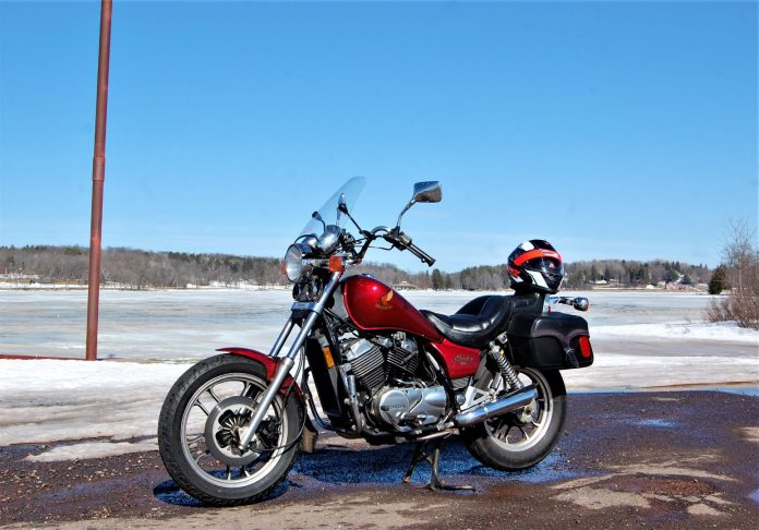 With still-frozen Sunday Lake and a dazzling blue sky as background, my 1985 Honda VT500 Shadow was on the road for its first ride of 2021.